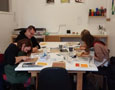 The group getting into cutting their lino blocks